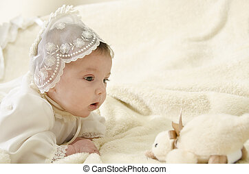Little baby and duck - Little baby with cereminial cap lying