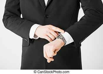 man looking at wristwatch - close up of man looking at...