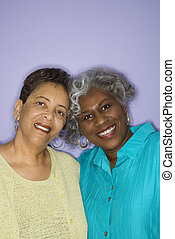 Women friends smiling. - Mature adult African American...
