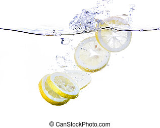 Lemon Slices in Water - Lemon slices splashing in water -...
