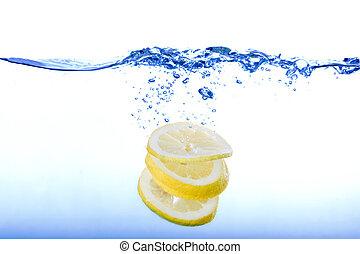 Lemon Water Splash - Lemon slices droping in clean blue...