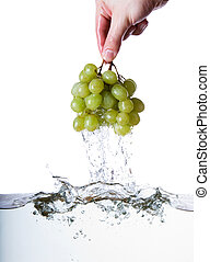 Wet Grapes - Grapes being pulled out of water