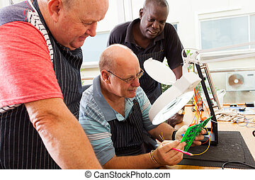group of senior electrical technicians - group of senior...