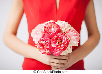 woman hands with bouquet of flowers