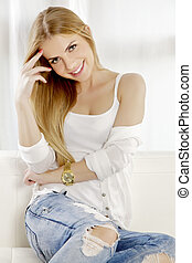 Beautiful and attractive young adult smile blonde woman...
