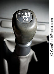 Gear Shift Stick - A gear shifter with 5 speeds in an older...