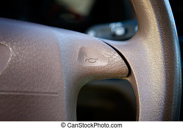 Car Horn - A car horn on a steering wheel