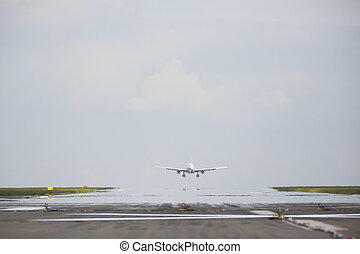 Runway - Airplane is landing on the airport