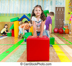 Cute children in gym - Cute children playing in kindergarten...