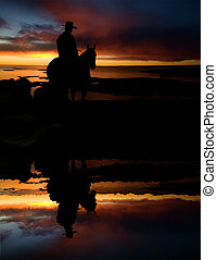 Cowboy at Watering Hole - A cowboy on a round up at a...