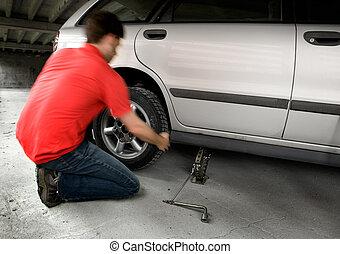 Quick Tire change - A male changing a tire quickly
