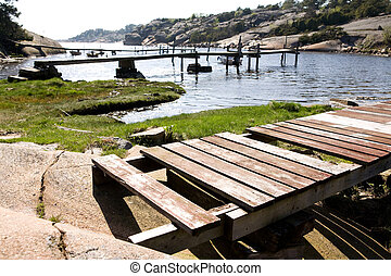 Old Dock - A number of old docks on an ocean inlet