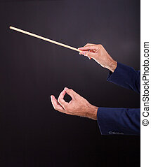hands of the conductor on black background