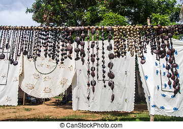 Crafts embroidered tablecloths and necklaces seed in Nosy...
