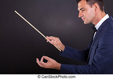 conductor with eyes closed - male conductor with eyes closed...