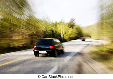 Fast Traffic - A motion blur image of a speeding car