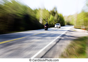Speeding Car - A motion blur image of a speeding car