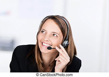 Customer Service Operator Conversing On Headset - Happy...