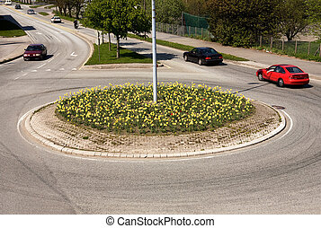 Roundabout - A traffic circle with flowers planted in the...