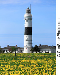 The lighthouse of Kampen on the Island of Sylt in May - The...
