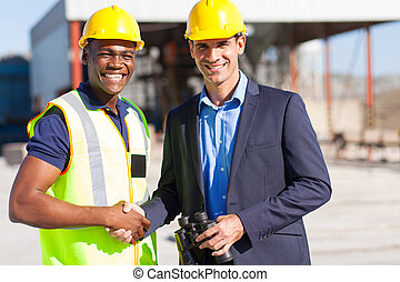 industrial manager and worker outdoors