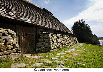 Viking Long House - A viking longhouse on the coast of...