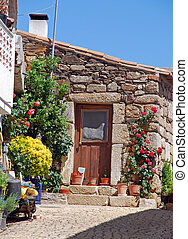 old stone house with door and flowers - old stone rural...
