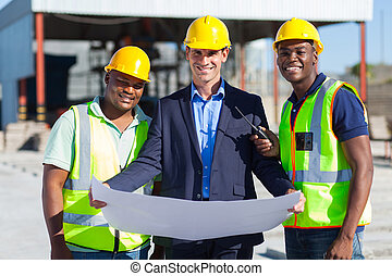 architect team on construction site - cheerful man architect...