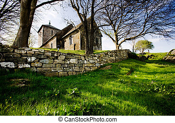 Old Stone Church - A stone church on a green meadow