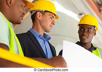 industrial manager and workers working on planning - group...