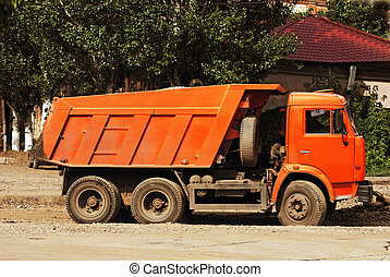 roadwork truck - A right view of orange roadwork truck