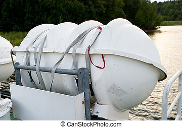 Life Raft - A life raft on the side of a boat ready for...