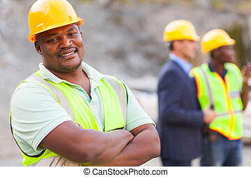 african mine worker - smiling african mine worker at mining...