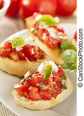 Homemade Tomato and Basil Bruschetta with olive oil on toast