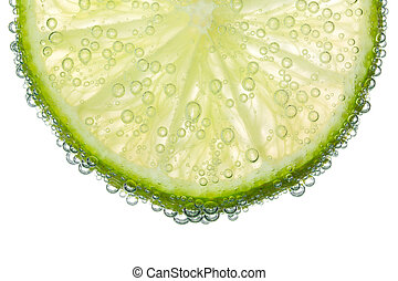 Lime Slice in Clear Fizzy Water Bubble Background Isolated