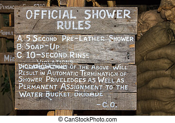 Official shower rules on a military site with scarce...