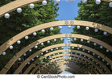 wooden arches with lanterns in a Moscow park Sokolniki
