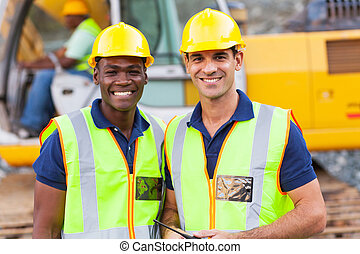 road construction workers - two cheerful male road...