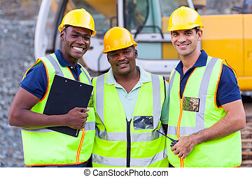 smiling construction workers - portrait of smiling...