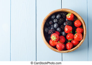 Summer Fruit Bowl Overhead - A shabby old wooden bowl of...