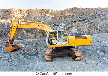 mine worker operating excavator on site - mine worker...
