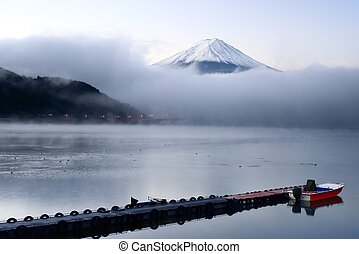 Mt. Fuji and Lake Kawaguchi - Mt. Fuji peaks from the clouds...