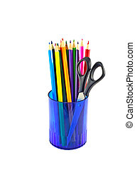 Multicolored pencils in blue glass with scissors