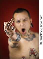 Man holding up middle finger - Caucasian mid-adult man with...