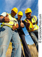 construction workers giving thumbs up - happy construction...