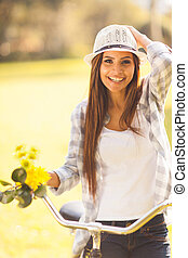cheerful young woman in a bicycle outdoor