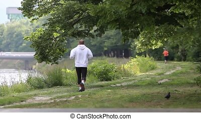 My lifestyle is sport - Two man jogging in the nature...