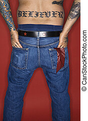 Man with tattoo reading believer. - Caucasian mid-adult man...