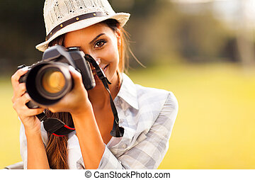 attractive young woman taking pictures - attractive young...