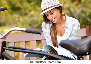 cute woman studying at the park